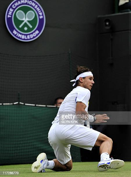 Spanish player Rafael Nadal falls as he plays with Luxembourg player Gilles Muller during the men's single at the Wimbledon Tennis Championships at...