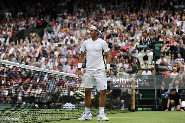Spanish player Rafael Nadal gestures as he plays against Michael Russell of US during the 2011 Wimbledon Tennis Championships at the All England...