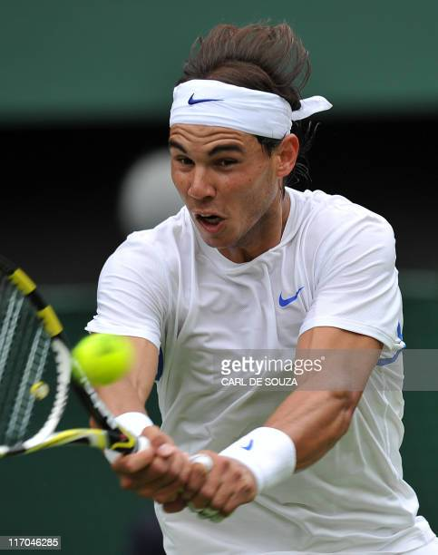 Spanish player Rafael Nadal plays against Michael Russell of US during a Men's Singles match at the 2011 Wimbledon Tennis Championships at the All...
