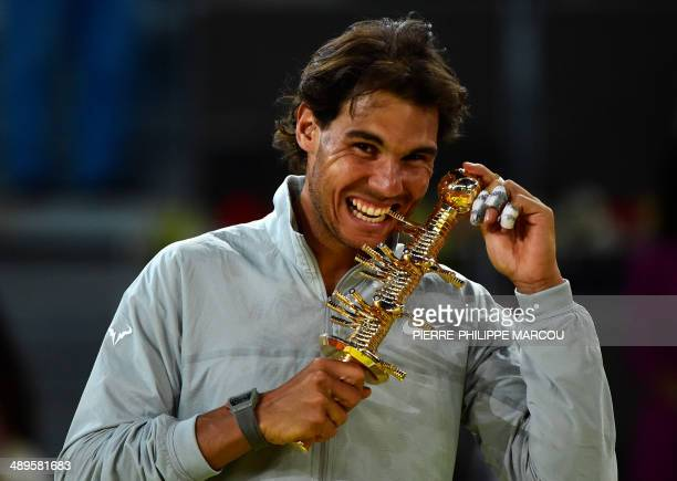Spanish player Rafael Nadal poses with the trophy after winning the men's singles final tennis match against Japanese player Kei Nishikori at the...