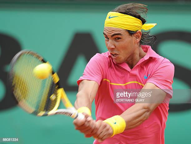 Spanish player Rafael Nadal returns a ball to Swedish player Robin Soderling during a French Open tennis round of 16 match on May 31 2009 at Roland...