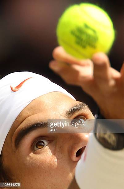 Spanish player Rafael Nadal serves a ball to Czech player Tomas Berdych during the men's singles grand final of the Wimbledon Tennis Championships at...
