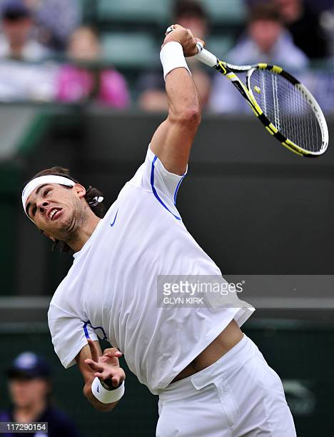 Spanish player Rafael Nadal serves to Luxembourg player Gilles Muller during the men's single at the Wimbledon Tennis Championships at the All...