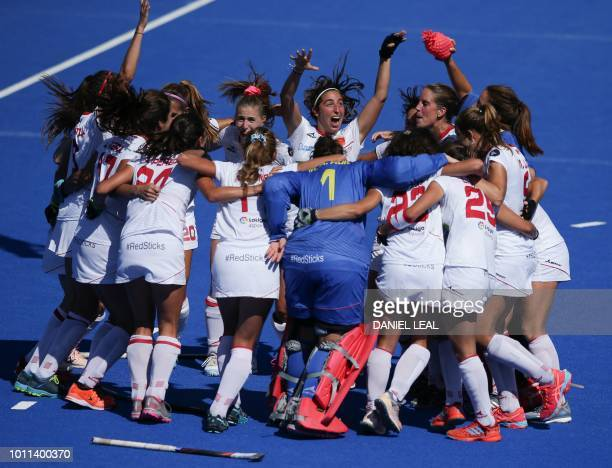 Spanish players celebrate after winning the bronze medal field hockey match between Australia and Spain during the 2018 Women's Hockey World Cup at...