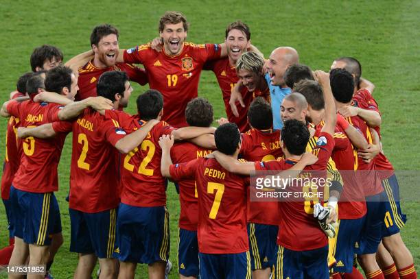 Spanish players celebrate after winning the Euro 2012 football championships final match Spain vs Italy on July 1, 2012 at the Olympic Stadium in...