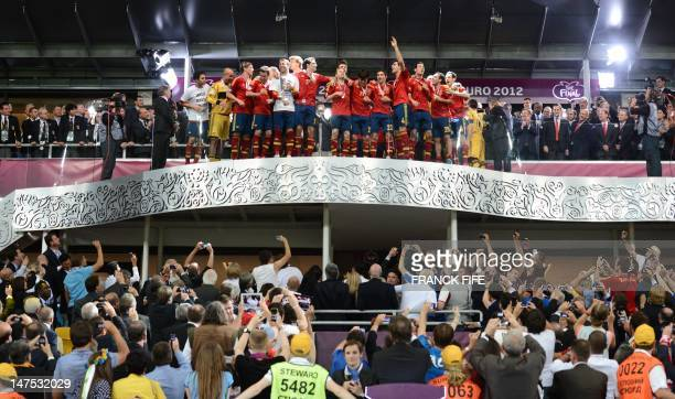 Spanish players celebrate after winning the Euro 2012 football championships final match Spain vs Italy on July 1 2012 at the Olympic Stadium in Kiev...
