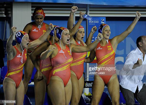 Spanish players celebrate after winning the women's water polo gold medal final match between Australia and Spain at the FINA World Championships at...