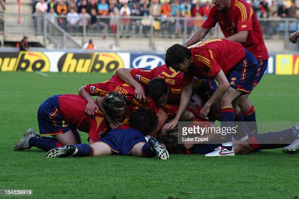 Spanish players celebrate together after equalising against Argentina. Argentina went on to win the match 3 - 1 at the Enschede Stadium, Enschede,...