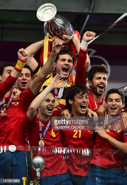 Spanish players celebrate with the trophy after winning the Euro 2012 football championships final match Spain vs Italy on July 1 2012 at the Olympic...