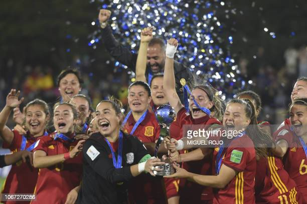Spanish players celebrate with the trophy after winning the U17 Women's World Cup final football match against Mexico in Montevideo on December 1...