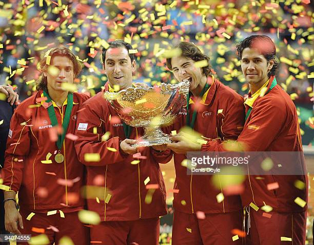 Spanish players David Ferrer , team captain Albert Costa Rafael Nadal and Fernando Verdasco celebrate with the Davis Cup trophy at the end of the...
