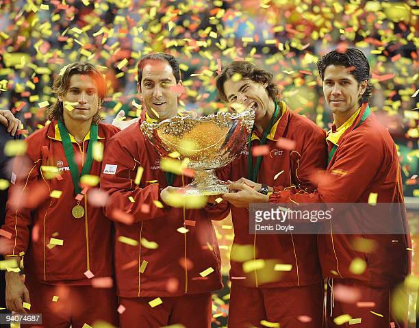 Spanish players David Ferrer team captain Albert Costa Rafael Nadal and Fernando Verdasco celebrate with the Davis Cup trophy at the end of the final...