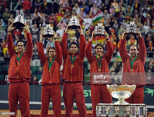 Spanish players Feliciano Lopez David Ferrer Fernando Verdasco Rafael Nadal and team captain Albert Costa celebrate with the Davis Cup trophy at the...