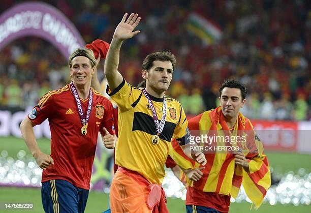 Spanish players Fernando Torres Iker Casillas and Xavi Hernandez celebrate after winning the Euro 2012 football championships final match Spain vs...