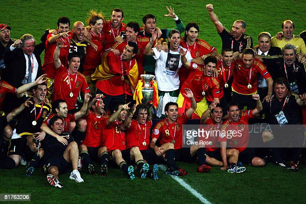 Spanish players pose for a team photograph with the trophy after winning against Germany the UEFA EURO 2008 Final match between Germany and Spain at...