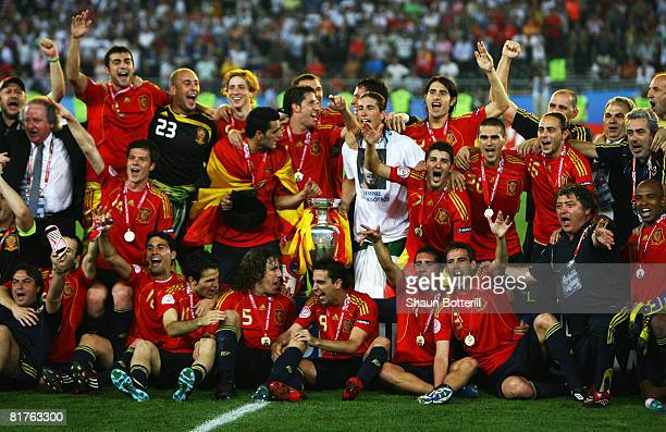 Spanish players pose for a team photograph with the trophy after winning against Germany in the UEFA EURO 2008 Final match between Germany and Spain...