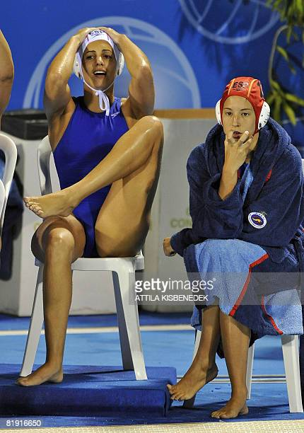 Spanish players react as they watch the final match against Russia on July 12 2008 in the aquatic center swimming pool of Spanish seaside town Malaga...