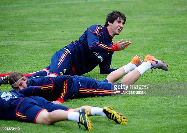 Spanish players Sergio Ramos and Javi Martinez lay on the grass during their today's second training at their Austrian training camp in the Aktivpark...