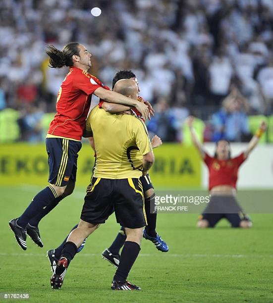Spanish players Spanish forward Sergio Garcia Spanish goalkeeper Jose Manuel Reina and Spanish midfielder Santiago Cazorla celebrate after the Euro...