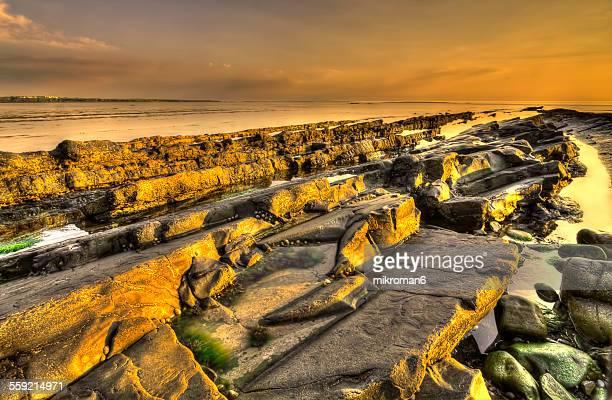 Spanish Point - goldish rock at sunset
