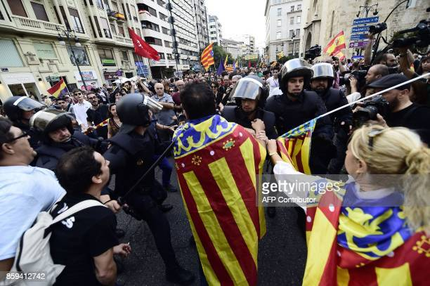 Spanish police forces try to separate rightwing nationalists from protesters calling for Catalan independence during counter demonstrations in...