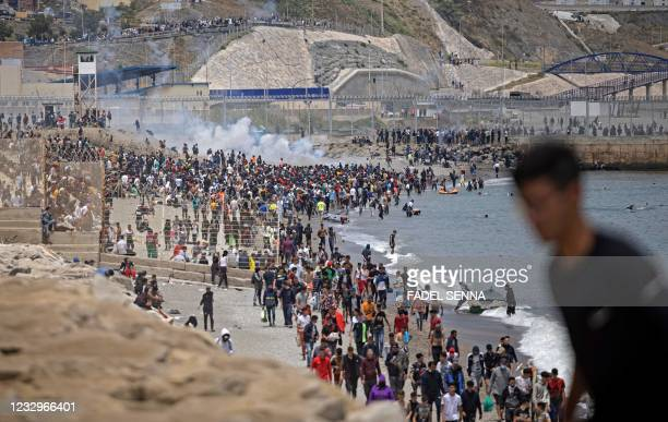Spanish police tries to disperse migrants at border between Morocco and the Spanish enclave of Ceuta on May 18, 2021 in Fnideq. - At least 5,000...
