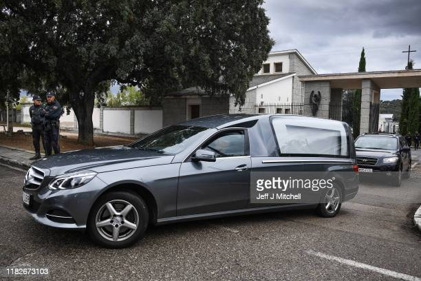 Spanish police watch as a hearse leaves the cemetery at El Padro where the remains of Spanish Dictator Francisco Franco will be interred on October...