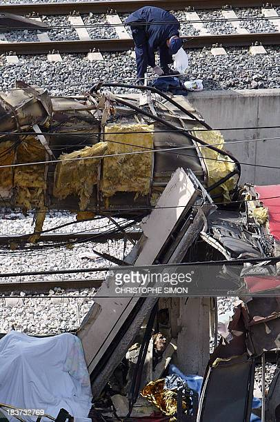 A Spanish policeman intervenes after a train blast at the Santa Eugenia Railway Station in Madrid 11 March 2004 Spain's political parties said today...