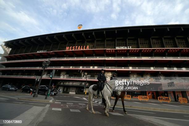 Spanish policemen patrol on horses outside the Mestalla stadium in Valencia on March 10, 2020 before the UEFA Champions League round of 16 second leg...