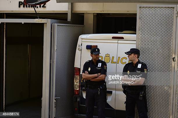 Spanish policemen stand guard as a police van carrying the parents of Ashya King the fiveyearold British boy with a brain tumour who was taken from...