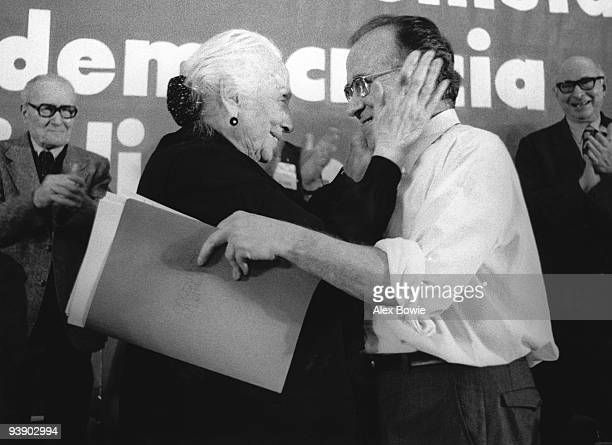 Spanish politician Dolores Ibarruri Gomez known as 'La Pasionaria' congratulates Communist Party GeneralSecretary Santiago Carrillo on his speech on...