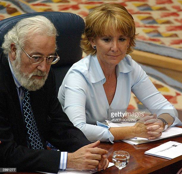 Spanish Popular Party deputies Eduardo Cortes and Esperanza Aguirre look at elected on the lists of the Spanish Socialist Party Eduardo Tamayo and...