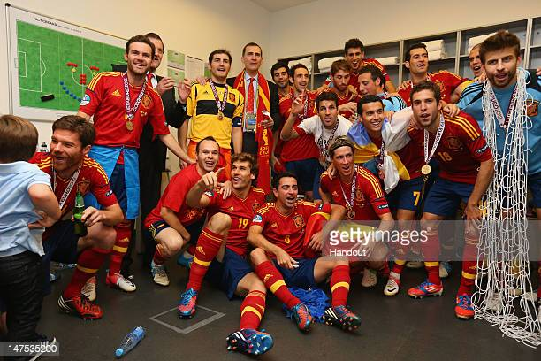 Spanish president Mariano Rajoy and Prince Felipe of Spain pose with the Spain team in the dressing room and following the UEFA EURO 2012 final match...