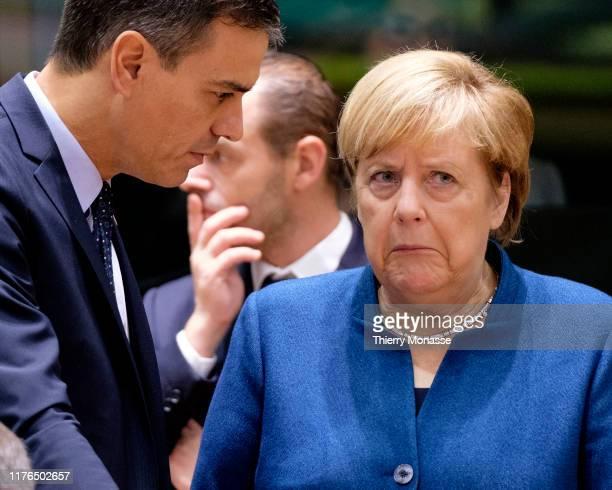 Spanish President of the government Pedro Sanchez PerezCastejon talks with the German Chancellor Angela Merkel ahead of round table talks at a EU...