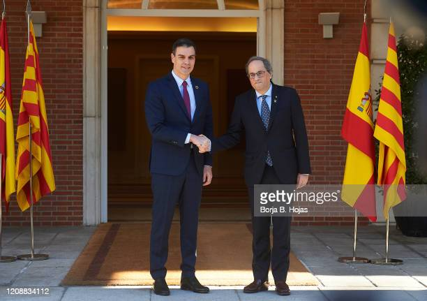 Spanish President Pedro Sanchez and Catalonia's President, Joaquim Torra before their meeting at Moncloa Palace on February 26, 2020 in Madrid,...