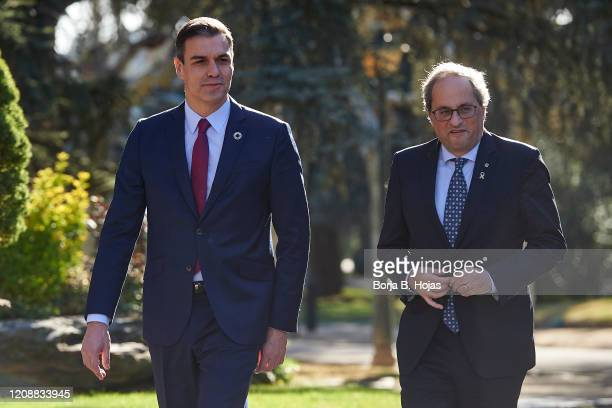 Spanish President Pedro Sanchez and Catalonia's President, Joaquim Torra arrives to Moncloa Palace before their meeting on February 26, 2020 in...