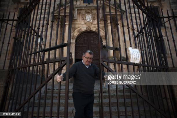 """Spanish priest Serafin closes the doors of the church """"Los Descalzos"""" in Ronda on April 7 as Holy Week processions were cancelled during a national..."""