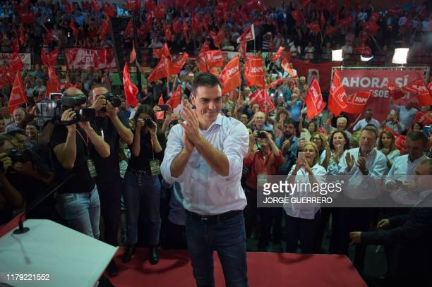 Spanish Prime Minister and candidate for the Spanish Socialist PSOE party Pedro Sanchez applauds on stage during a rally to launch the party's...