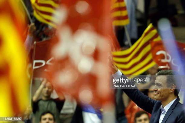 Spanish prime minister and leading candidate for Spanish Socialist Party Pedro Sanchez waves to supporters during a campaign rally in Barcelona on...