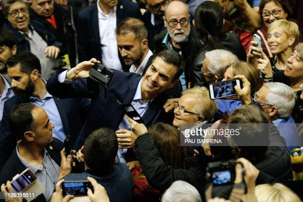 Spanish prime minister and leading candidate for Spanish Socialist Party Pedro Sanchez takes photos with supporters during a campaign rally in...