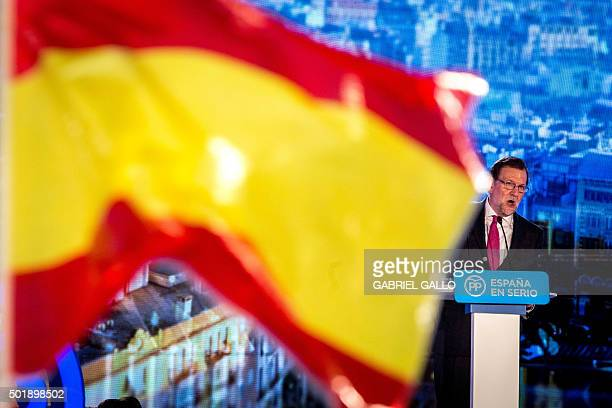 Spanish Prime Minister and Popular Party leader and candidate for the upcoming December 20 general election Mariano Rajoy speaks behind a Spanish...