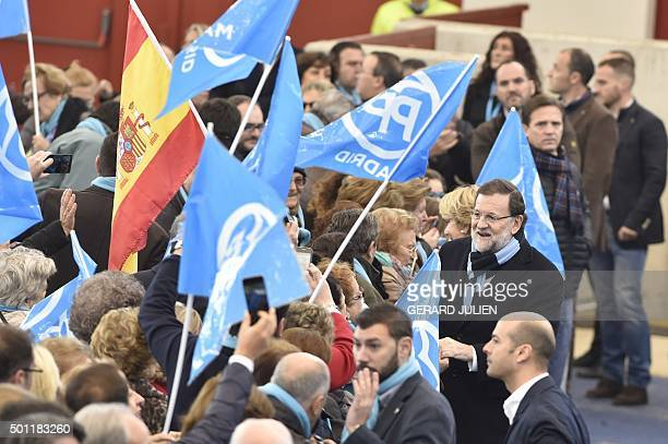 Spanish Prime Minister and Popular Party leader and candidate in the December 20 general elections Mariano Rajoy gestures during a meeting in Las...