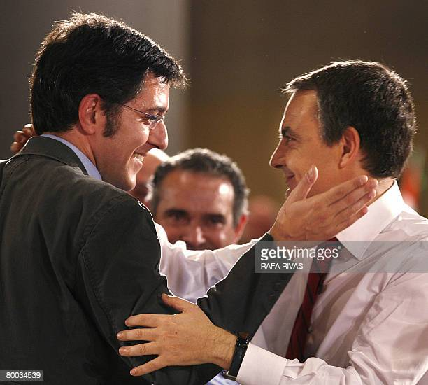 Spanish Prime Minister and Socialist Party candidate for the Spanish general elections Jose Luis Rodriguez Zapatero greets Spanish Socialist Party...