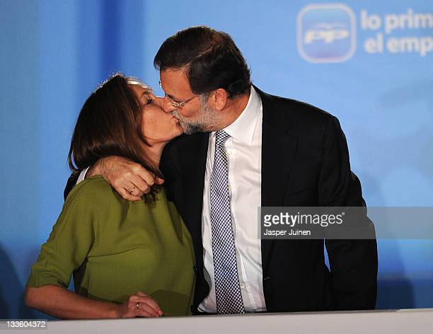 Spanish Prime Minister elect Mariano Rajoy of the Popular Party kisses his wife Elvira as he celebrates his party's win in the Spanish general...