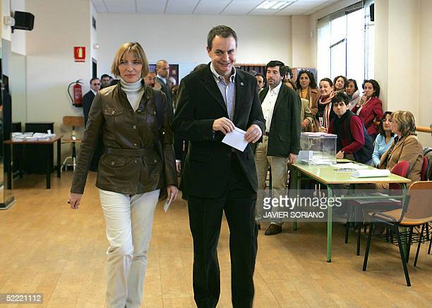 Spanish Prime Minister Jose Luis Rodriguez Zapatero and his wife Sonsoles Espinosa walk to the electoral desk before casting their vote in Spain's...