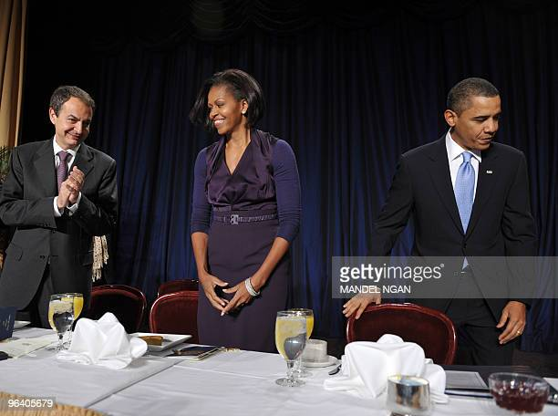 Spanish Prime Minister Jose Luis Rodriguez Zapatero applauds as US President Barack Obama and First Lady Michelle Obama arrive for the 58th US...