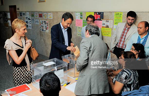 Spanish Prime Minister Jose Luis Rodriguez Zapatero casts his ballot for Spain's regional elections with his wife Sonsoles Espinosa at the Colegio...