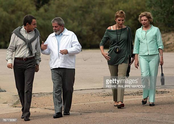 Spanish Prime Minister Jose luis Rodriguez Zapatero chats with Brazilian President Luiz Inacio Lula da Silva as their wives Sonsoles Espinosa and...