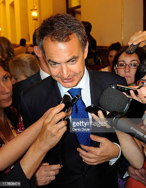 Spanish prime minister Jose Luis Rodriguez Zapatero is surrounded by members of the press after giving his last state of the nation address to the...