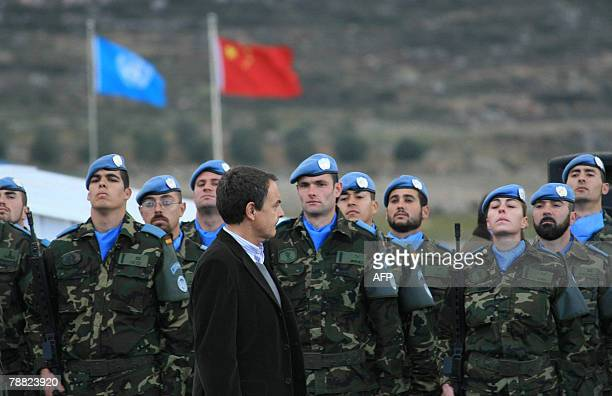 Spanish Prime Minister Jose Luis Rodriguez Zapatero reviews an honour guard at the base of Spanish troops serving with the United Nations Interim...